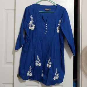 Blue shirt with white flowers